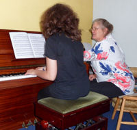Ronwen giving a piano lesson